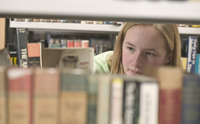 Girl looking at books.