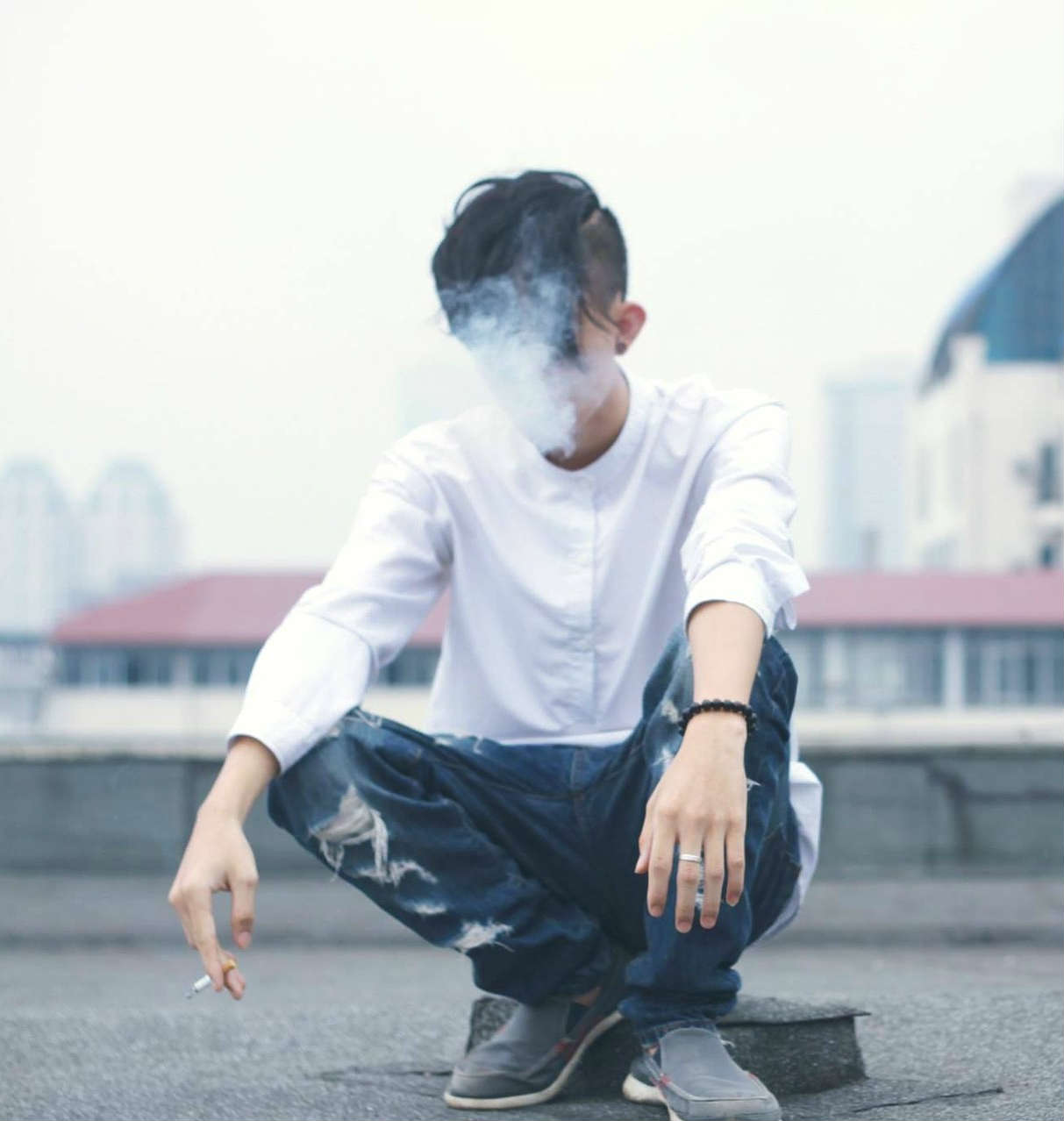 Teenage boy smoking